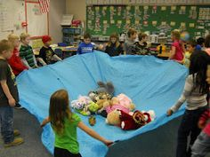 moppets use a sheet instead of parachute - circle time or outside activity.