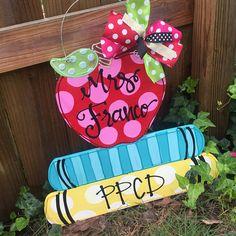 Apple teacher door hanger hand lettered apple and books Teacher Door Hangers, Teacher Doors, Teacher Wreaths, Wood School, Door Hanger Template, Back To School Crafts, Ideas Para Organizar, Door Tags, School Decorations