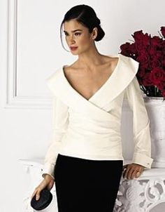a blouse ... a white blouse with a beautiful collar.