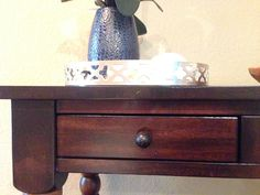 Three drawers across the front with hammered bronze knobs.
