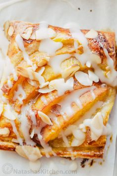 Peach tartlets with juicy peaches, toasted almonds & vanilla glaze over a…