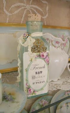 Marie Antoinette craze in decorating french ambiance. embellished glass bottles.