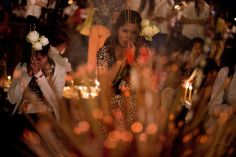 Feb. 1, 2013. Cambodians pray and burn incense sticks as they pay respects to the late former King Norodom Sihanouk in front of the Royal Palace in Phnom Penh, Cambodia.