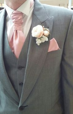 Silver/Grey 3 piece Tailcoat suit with a light rose cravat and hankie.