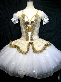 New Creation 2015-2016 This princess-like tutu is created for the role of Cinderella. The bodice was created using gold brocade and shiny brown trims and features a gold central insert, embellished by
