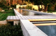 The dock-like style of this California wine country pool designed by Eliot Lee proves that manmade swimming pools can be natural and unobtrusive.