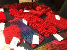 An assortment of hand-knit scarves by volunteers that will be donated to women cardiac patients as part of the WomenHeart HeartScarves program