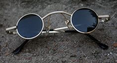 Unisex, Small round Goth steampunk Vampire sunglasses with extra long bridge.  Suits most faces, small to medium fit. Metal frame. Measurements are as follows Frame across 124mm hinge to hinge Diameter of lens including the frame is 35mm Bridge 35mm Temples 110mm till they curve Lens Material poly carbonate with UV 400 protection Lenses are flat. Small Round Sunglasses, Retro Sunglasses, Mirrored Sunglasses, Mens Sunglasses, Glasses Trends, Lunette Style, Steampunk Sunglasses, Sherlock Holmes, Eyeglasses
