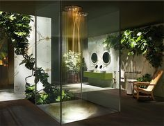 This tropical bathroom looks like it belongs in the heart of the Amazon. Lighting has been kept to a minimum to mimic the shadowy forest floor. Centre stage are Gessi's multifunction recessed ceiling-mounted shower heads, featuring optional lighting and three different spray selections. Gessi 40527 trim set shower head rom £5,565. westonebathrooms.com