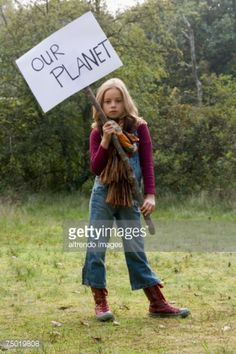Stock Photo : Girl holding sign in forest