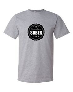 Premium Sober bottle cap on Dark Grey Heather color shirt100% ring-spun lightweight cottonPre-shrunkTubular constructionShoulder-to-shoulder tapeSeamless collarDouble-needle sleeve and bottom hemThis is a classic tee that has a light feel. Made of 100% ring-spun cotton (except for heather colors, which contain 10% polyester).