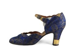 Shoe-Icons / Shoes / Elegant strap shoes with upper made of navy blue brocade with gold leaves pattern and gold and silver leather inserts.
