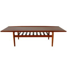 Grete Jalk Danish Modern Teak Coffee Table | From a unique collection of antique and modern coffee and cocktail tables at http://www.1stdibs.com/furniture/tables/coffee-tables-cocktail-tables/