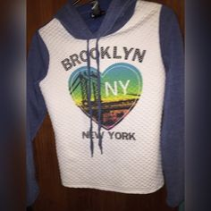 Brooklyn New York Hoodie ✳️⚜CONDITION : Good condition has been worn only once but no stains, or holes ✳️ ⚜ COLOR : Blue / White/ Black  multi color graphic ✳️ ⚜ FIT : Fit is comfortable for XS & tight arms on a small (me) ✳️⚜ SIZE : M ✳️⚜ NOT : TRADING! ✳️⚜ I SHIP : Monday - Friday's , and in 1-2 days !  ✳️ ⚜ WILL : Hold during Saturday & Sunday until I can ship for you ! ✳️ ⚜ PLEASE : remember I do need to make some kind of profit ! ✳️ ⚜ ALWAYS : Make an offer ! Tops Sweatshirts & Hoodies
