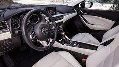 Ugh..Idk. I don't like Mazda 6's but I do like those seats. The steering wheel looks even clunkier and more frustrating as ever. New Mazda's have such awkward steering wheels, I've gotten used to my 3 though.