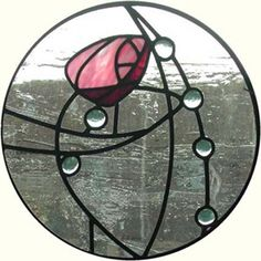 Graceful Charles Renee Mackintosh stained glass window.