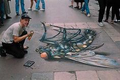 Julian Beever and one of his amazing 3-D sidewalk chalk drawings