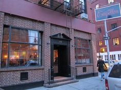 Exterior view of Empellon NYC Mexican restaurant with brick facade and maroon trim