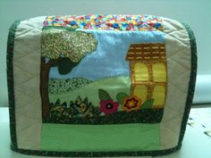 Sewing machine cover. You could use your orphan blocks!
