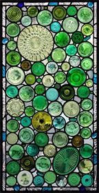"""OCEAN THEMED """"GREEN BOTTOMS"""" WINDOW - reclaimed or recycled green glass """"bottoms"""" (bottles, vases, stemware, serving plates) + inclusion of """"sea glass"""" found at a local beach; addition of greenish blue plate fragments and jewels in the border give the window's color range an ocean feel"""