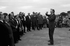 A male voice choir practising on the seafront at Porthcawl during the Miners' Eisteddfod