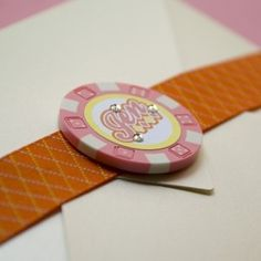 """Nothing says """"Bachelorette Party"""" like this pink and orange Las Vegas invite! Adorned with a real poker chip and Swarovski crystals, a metallic ivory pochette unveils the fun details."""