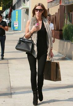 772e15268742 Nicky Hilton Nicky Hilton shows off her model body in a black T-shirt and