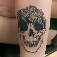 Daisy + Skull tattoo done at Tiny Tim's Baltimore Ave Tattoo in Media, PA