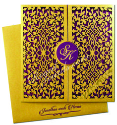 These Gold Laser-cut invitations will leave your guests spellbound. Gold foil couple Initials on card front is customizable. #Lasercutinvites #personalizedinvitations #regalcards #lasercutinvitationcards #exclusiveinviattioncards #designerweddingcards #lasercutweddingcards