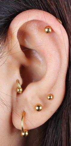 Cute Simple Multiple Ear Piercing Ideas Gold Ball Stud Earring Studs for Cartila. - Piercings - Cute Simple Multiple Ear Piercing Ideas Gold Ball Stud Earring Studs for Cartila. Tragus Piercings, Medusa Piercing, Cute Ear Piercings, Peircings, Mens Piercings, Piercing Types, Tragus Stud, Facial Piercings, Lip Piercing