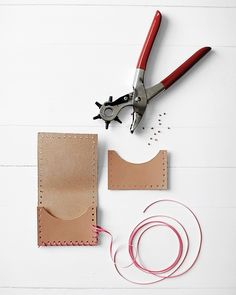 DIY:Leather Crafts #diy . . . I like the hole punch idea around the edges with the leather string