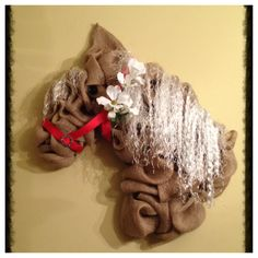 Here's a horse head wreath made of burlap.
