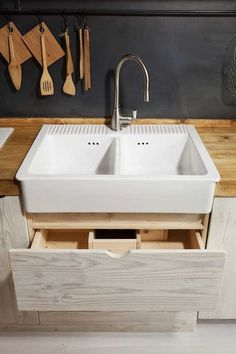 Katrin Arens Kitchen in Bergamo | Remodelista. Pull out drawers under sink.
