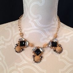 Kitsy Lane statement necklace gold NWOT New without tags! Black, taupe, and clear jewels on a gold chain with lobster clasp. Comes in a little velvet dust bag. Let's make a bundle deal! Kitsy Lane Jewelry Necklaces