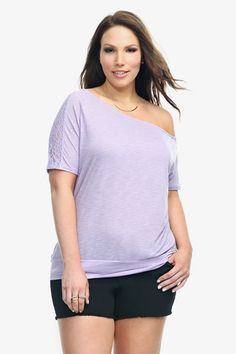 Revealing a peek of skin through cut-lace shoulder insets, this slub knit tee delivers casual style with flirty sex appeal. Features an off-shoulder silhouette and a banded bottom.