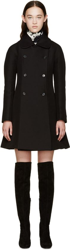 Long-sleeve peacoat in black. Peter Pan collar. Double-breasted button-up closure. Fully lined.