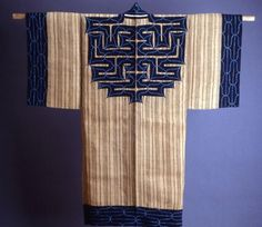 """Attus"" Amip (Man's Coat), c. 1860    Ainu    Japan, Hokkaido Island    Elm tree bark fiber, plain weave    Center back and outer edges appliquéd with cotton, plain weave; underlaid with cotton, plain weave; embroidered with cotton in laid work and couching"