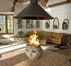 An indoor fire pit. The hood kinda dominates, but. gotta have a hood! Fire Pit Hood, Fire Pit Chimney, Fire Pits, Cabin Fireplace, Custom Fireplace, Fireplace Surrounds, Indoor Outdoor Fireplaces, Outdoor Fireplace Designs, Portable Propane Fire Pit