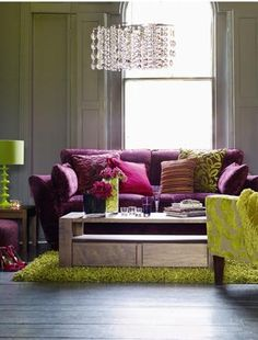 How fun!! Purple and green living room. What color is that wall?  I bet you didn't notice. It sets the scene without making a scene.