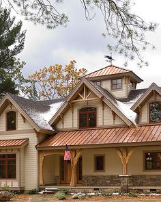 https://flic.kr/p/7iJmQy   Timber Treasure Timber Frame Home - Exterior Porch   A timbered porch adorns the front of the home topped with the copper roof for added style.