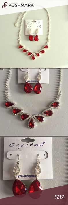 Rhinestone necklace and earring set Rhinestone and ruby colored gemstone teardrop necklace and earring set. New. Never been worn. Jewelry Necklaces