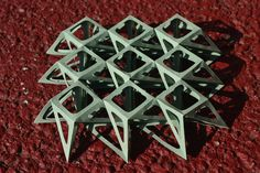 """Specifically, to quote Robert Lang,  """"a twisted-top, closed-bottom {8.8.4} version of the family of 3D origami tessellations described by Ron Resch in his 1966 patent."""" I removed all that unnecessary paper, leaving just enough to support the crease pattern.  From an 11 inch square of 24 lbs. Neenah linen-finish paper. (They say linen, but it's really cotton.) Bossed and cut with a KNK Zing."""