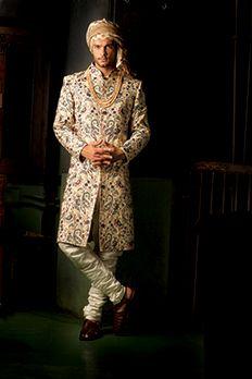 Pure silk Sherwani embroidered with multi colour resham work by #Benzer #Benzerworld #Sherwani #SherwaniForGroom #IndianGroom #MensWear