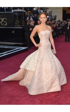 Jennifer Lawrence  WHAT:    Christian Dior Haute Couture dress, Chopard jewelry, and Roger Vivier clutch  WHERE:    The Oscars, Hollywood  WHEN:    February 24, 2013