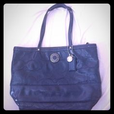 Navy Blue Coach Purse This was my very first Coach purse and I was so in love! It's in tip top shape besides a few lipgloss stains and a little wear  Coach Bags