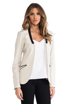 No collar blazer is gorgeous. Makes a corporate piece simple and relaxed