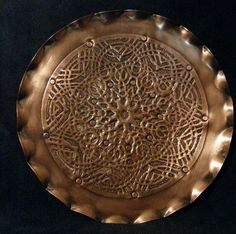 Copper, hand engraved and hammered