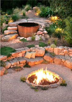 Semi-sunken hot tub, terraced patio, stone benches, fire pit