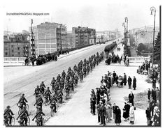 Shocked Poles watch as German soldiers on bicycles move intoWarsaw