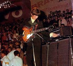 george tweaking the amp, germany, 1966